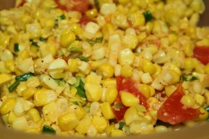 Sweet corn salad with tomato and green onions sauteed in butter